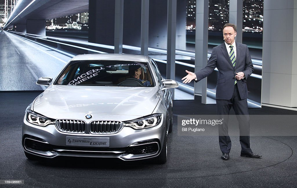 Dr. Ian Robertson, Member of the Board of Management of BMW AG, Sales and Marketing, reveals the Concept 4 Series Coupe at its world debut at the 2013 North American International Auto Show media preview at the Cobo Center January 14, 2013 in Detroit, Michigan. Approximately 6,000 members of the media from 68 countries are attending the show this year. The 2013 NAIAS opens to the public January 19th.