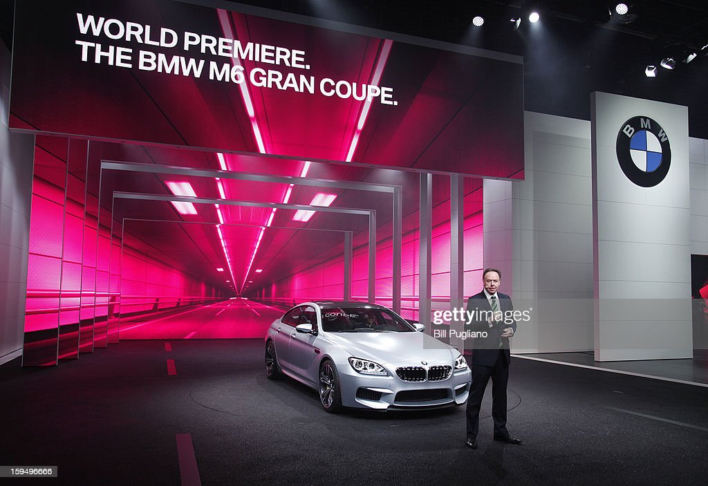 Dr. Ian Robertson, Member of the Board of Management of BMW AG, Sales and Marketing, reveals the 2014 BMW M6 Gran Coupe at its world debut at the 2013 North American International Auto Show media preview at the Cobo Center January 14, 2013 in Detroit, Michigan. Approximately 6,000 members of the media from 68 countries are attending the show this year. The 2013 NAIAS opens to the public January 19th.