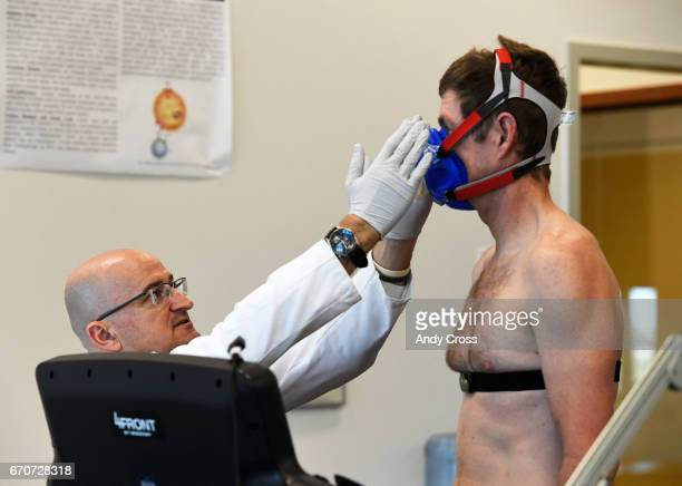 Dr Inigo San Millan left adjusts a breathing apparatus for triathlete Zach Barber before a metabolic and physiologic test in a lab at the University...