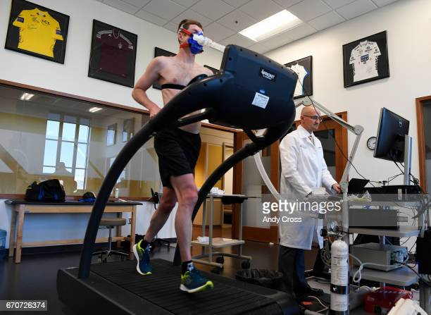 Dr Inigo San Millan right reads data on the computer as triathlete Zach Barber runs on the treadmill during a metabolic and physiologic test at the...