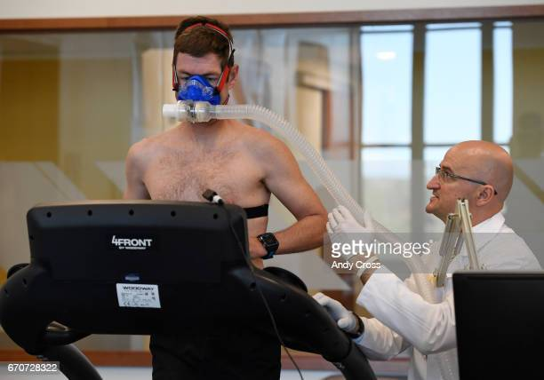 Dr Inigo San Millan right works with triathlete Zach Barber during a metabolic and physiologic test at the University of Colorado Sports Medicine...
