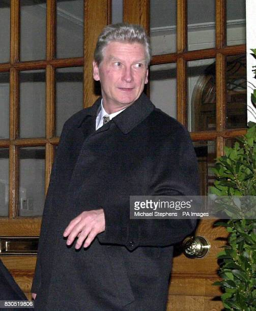 Dr Janusz Wszeborowski leaves the General Medical Council in central London after attending a hearing where he is accused of using excessive force to...