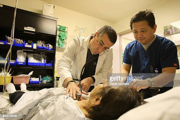 Dr Jason Greenspan and emergency room nurse Junizar Manansala care for a patient in the ER of Mission Community Hospital where doctors held a press...