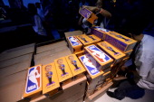 Dr Jerry Buss bobble heads are stacked for a fan giveaway before a game between the Los Angeles Lakers and the Indiana Pacers at STAPLES Center on...