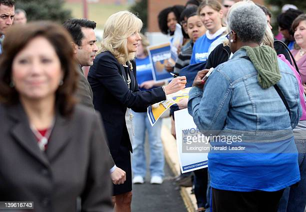 Dr Jill Biden center wife of Vice President Joe Biden signs autographs for students and staff at the Community and Technical College Leestown Campus...