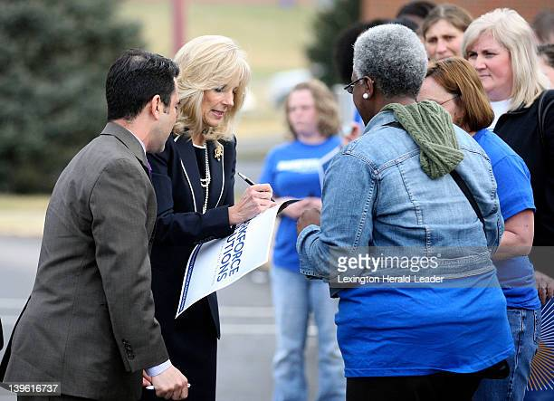 Dr Jill Biden second from left wife of Vice President Joe Biden signs autographs for students and staff at the Community and Technical College...