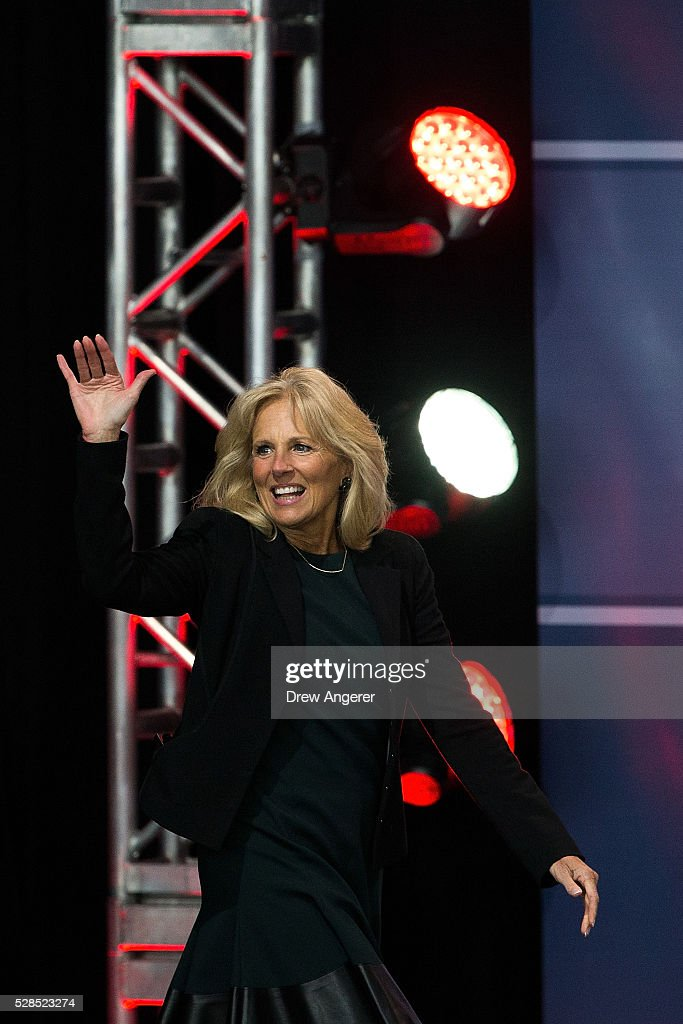 Dr. <a gi-track='captionPersonalityLinkClicked' href=/galleries/search?phrase=Jill+Biden&family=editorial&specificpeople=997040 ng-click='$event.stopPropagation()'>Jill Biden</a> waves as she arrives onstage during a comedy show organized by United Services Organizations (USO) for members of the military and their families, at Andrews Air Force Base, May 5, 2016, in Joint Base Andrews, Maryland. The program is also being live streamed for active duty service members stationed at bases domestically and abroad.