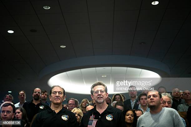 Dr Jim Green NASA Planetary Science Division Director an others wait during a countdown to the estimated time of the closest flyby of Pluto by the...