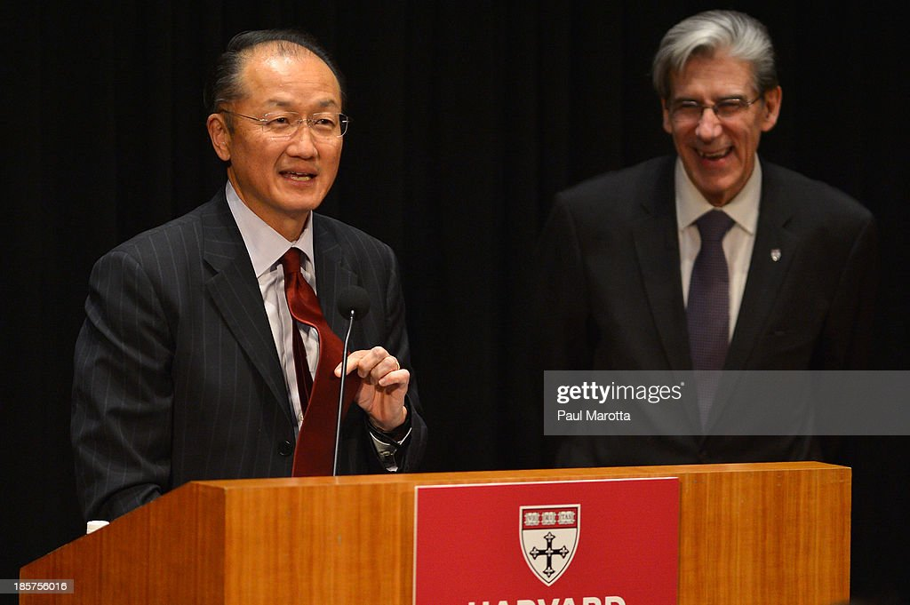 Dr. Jim Yong Kim (L), President of the World Bank Group, receives the Centennial Award from Harvard School of Public Health Dean of Faculty Julio Frenk on October 24, 2013 in Boston, Massachusetts.