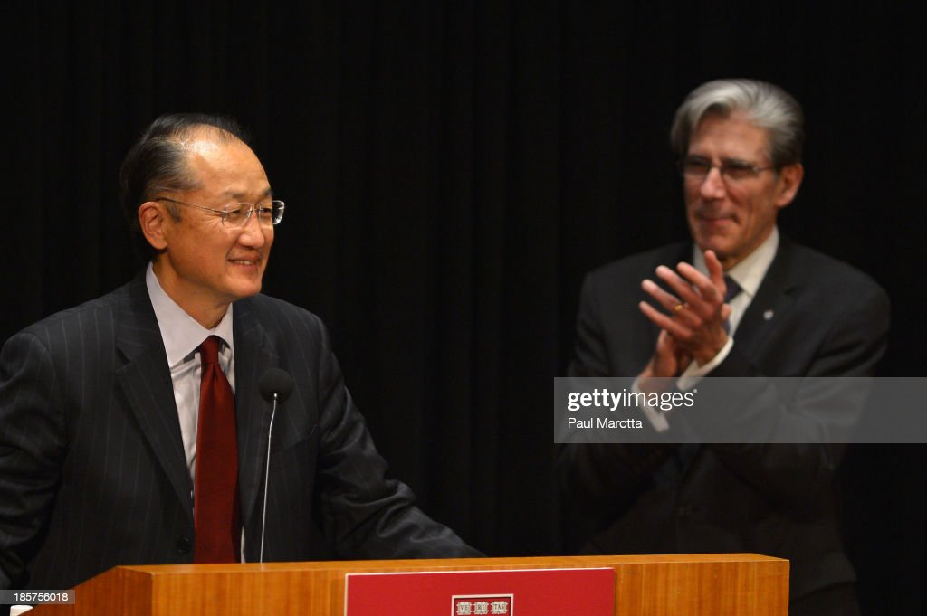Dr. <a gi-track='captionPersonalityLinkClicked' href=/galleries/search?phrase=Jim+Yong+Kim&family=editorial&specificpeople=2302483 ng-click='$event.stopPropagation()'>Jim Yong Kim</a> (L), President of the World Bank Group, receives the Centennial Award from Harvard School of Public Health Dean of Faculty Julio Frenk on October 24, 2013 in Boston, Massachusetts.