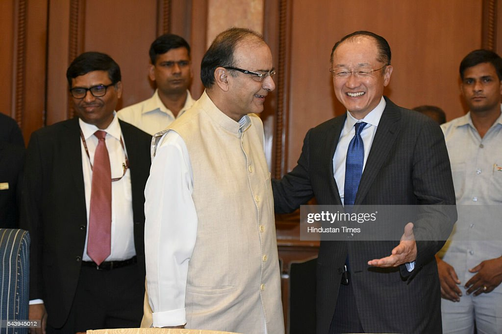 Dr. Jim Yong Kim, President, World Bank greets Finance Minister Arun Jaitle at Taj Mahal Hotel for the bilateral meeting and signing of agreement at Diwan-E-Aam on June 30, 2016 in New Delhi, India. The World Bank announced plans to provide more than $1 billion to support Indias solar initiatives. The World Bank Group will also collaborate with the 121-member International Solar Alliance, headquartered in India, with the aim of attracting $1 trillion in investments by 2030 to promote solar energy worldwide. (Photo by Sonu Mehta /Hindustan Times via Getty Images