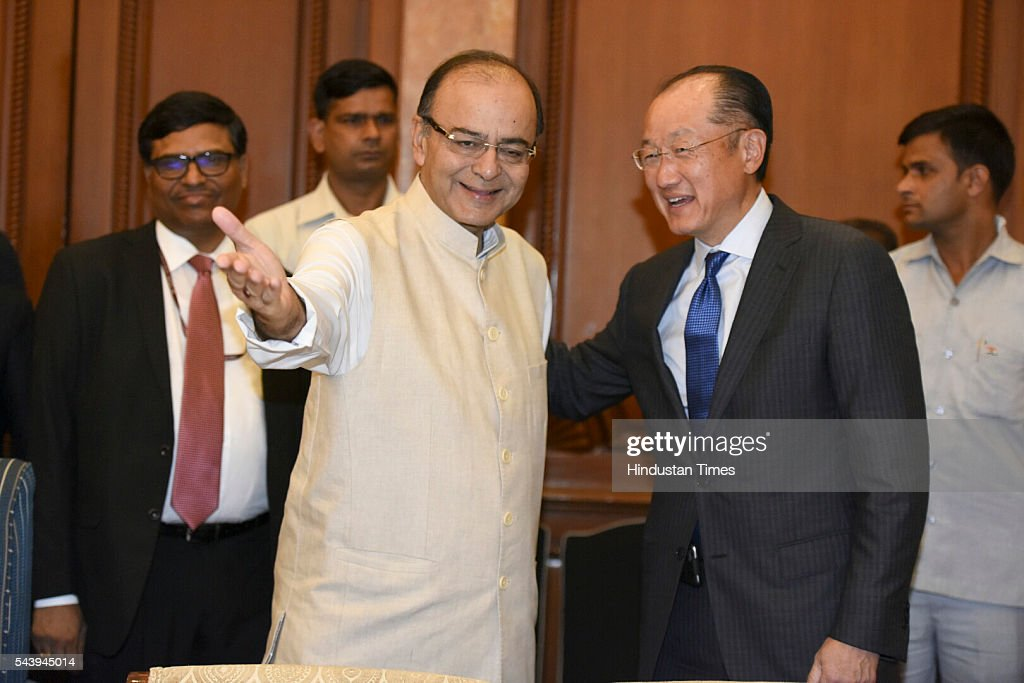 Dr. Jim Yong Kim, President, World Bank greets Finance Minister Arun Jaitle at Taj Mahal Hotel for the bilateral meeting and signing of agreement at Diwan-E-Aam on June 30, 2016 in New Delhi, India.The World Bank announced plans to provide more than $1 billion to support Indias solar initiatives. The World Bank Group will also collaborate with the 121-member International Solar Alliance, headquartered in India, with the aim of attracting $1 trillion in investments by 2030 to promote solar energy worldwide. (Photo by Sonu Mehta /Hindustan Times via Getty Images