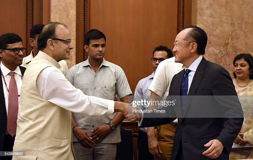 Dr. Jim Yong Kim, President, World Bank greets Finance Minister Arun Jaitle at Taj Mahal Hotel forthe bilateral meeting and signing of agreement at Diwan-E-Aam on June 30, 2016 in New Delhi, India. The World Bank announced plans to provide more than $1 billion to support Indias solar initiatives. The World Bank Group will also collaborate with the 121-member International Solar Alliance, headquartered in India, with the aim of attracting $1 trillion in investments by 2030 to promote solar energy worldwide. (Photo by Sonu Mehta /Hindustan Times via Getty Images