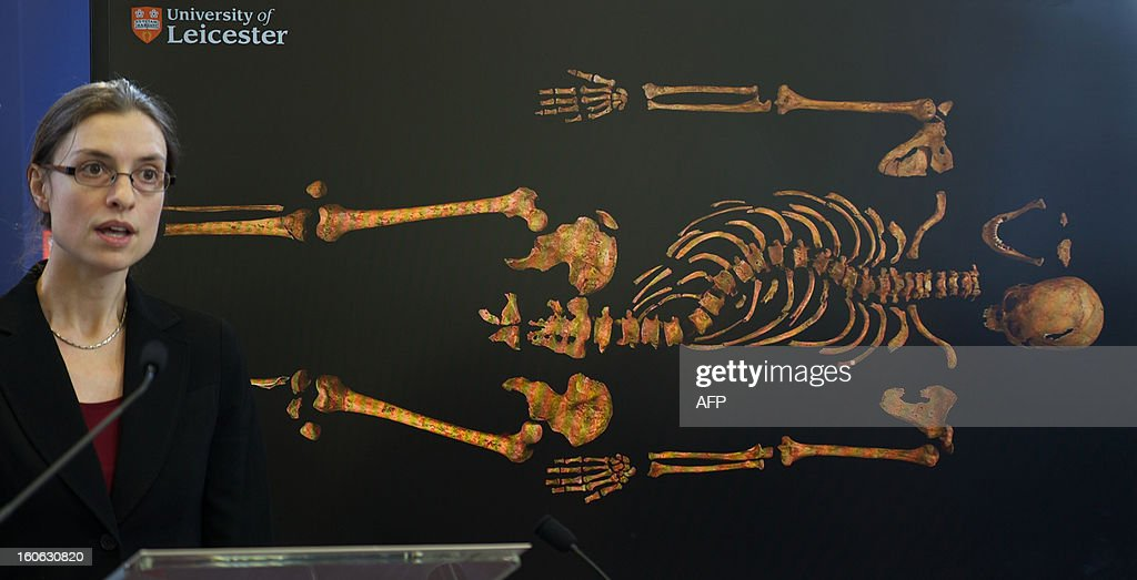 Dr Jo Appleby, a lecturer in bioarchaeology at Leicester University, addresses a press conference in front of an image of the skeleton of Britain's King Richard III, at the university in central England, on February 4, 2013. A skeleton found under a car park in the English city of Leicester is that of king Richard III, widely regarded as one of history's most notorious villains, scientists confirmed Monday. AFP PHOTO/ANDREW COWIE