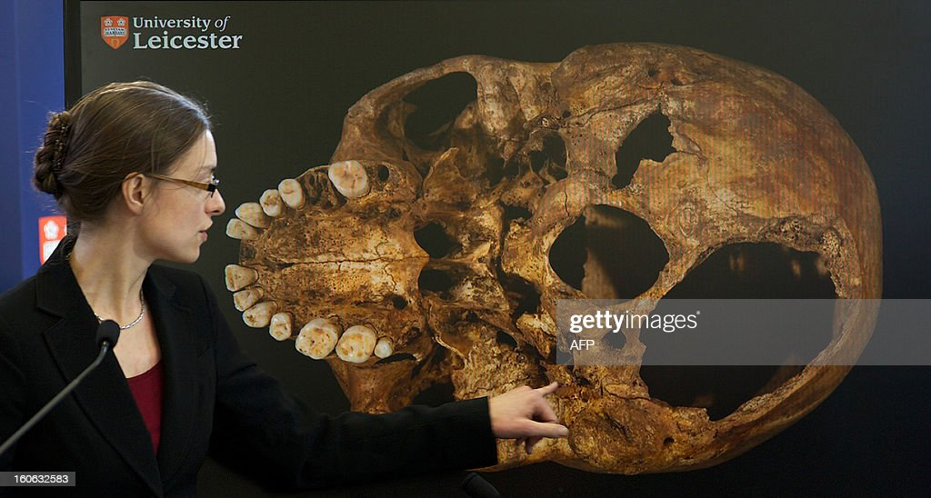 Dr Jo Appleby, a lecturer in bioarchaeology at Leicester University, points to an image of the skull of Britain's King Richard III, during a press conference at the university in central England, on February 4, 2013. A skeleton found under a car park in the English city of Leicester is that of King Richard III, widely regarded as one of history's most notorious villains, scientists confirmed Monday.