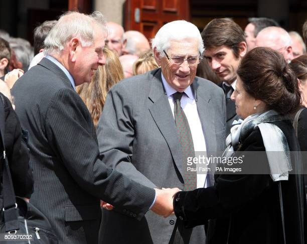 Dr Joe Hendron former west Belfast MP and Seamus Mallon former Deputy First Minister speak to Briege Napier wife of Sir Oliver Napier after his...