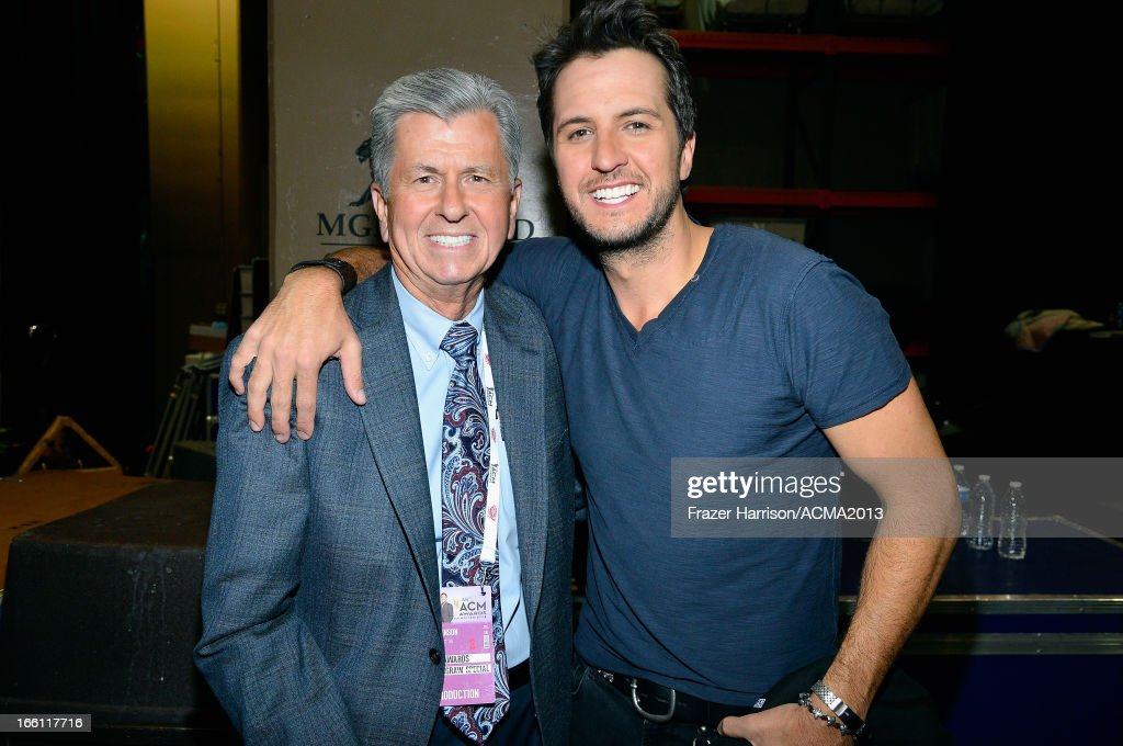 Dr. Joe Johnson (L) and musician Luke Bryan attend Tim McGraw's Superstar Summer Night presented by the Academy of Country Music at the MGM Grand Garden Arena on April 8, 2013 in Las Vegas, Nevada.