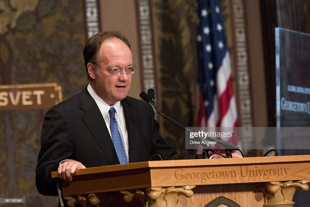 Dr. John J. DeGioia, president of Georgetown University, delivers remarks before introducing Warren Buffett and Bank of America CEO Brian Moynihan at Georgetown University, September 19, 2013 in Washington, DC. Moynihan moderated a discussion with Buffet, taking questions from Georgetown students.