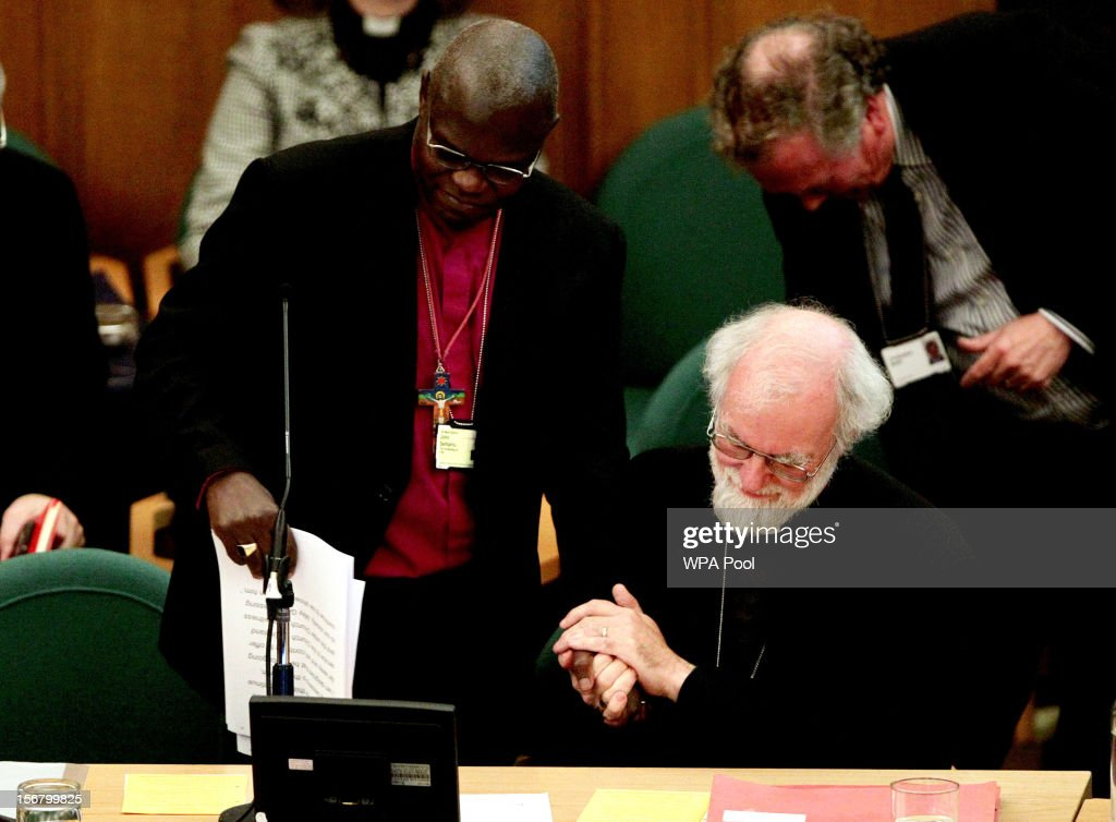 Dr <a gi-track='captionPersonalityLinkClicked' href=/galleries/search?phrase=John+Sentamu&family=editorial&specificpeople=623109 ng-click='$event.stopPropagation()'>John Sentamu</a> (L), Archbishop of York, and Dr <a gi-track='captionPersonalityLinkClicked' href=/galleries/search?phrase=Rowan+Williams&family=editorial&specificpeople=239468 ng-click='$event.stopPropagation()'>Rowan Williams</a>, the outgoing Archbishop of Canterbury, clasp hands during his farewell tributes at a meeting of the General Synod of the Church of England, at Church House on November 21, 2012 in London, England. The Church of England's governing body, known as the General Synod, yesterday voted to prevent women from becoming bishops. Dr <a gi-track='captionPersonalityLinkClicked' href=/galleries/search?phrase=Rowan+Williams&family=editorial&specificpeople=239468 ng-click='$event.stopPropagation()'>Rowan Williams</a> said that the Church of England had lost a 'measure of credibility', following the General Synod rejected the legislation.
