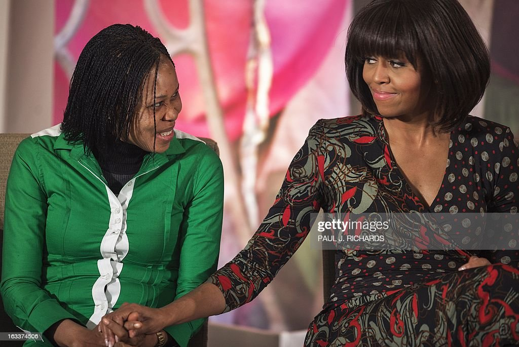 Dr. Josephine Obiajulu Odumakin of Nigeria is congrulated by US First Lady Michelle Obama (R) as she was presented with the Secretary of State's International Women of Courage Award inside the Dean Acheson Auditorium of the US Department of State March 8, 2013, in Washington. The Secretary of State's International Women of Courage Award annually recognizes women around the globe who have shown exceptional courage and leadership in advocating for women's rights and empowerment, often at great personal risk. Since the inception of this award in 2007, the Department of State has honored 67 women from 45 different countries. AFP Photo/Paul J. Richards