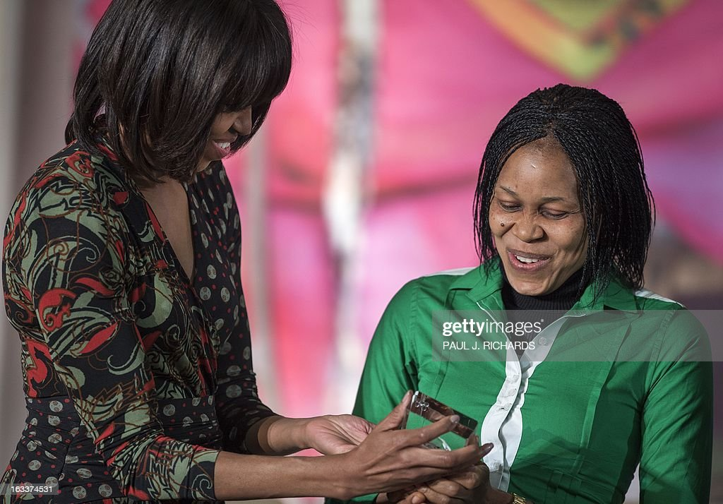 Dr. Josephine Obiajulu Odumakin of Nigeria is congrulated by US First Lady Michelle Obama (R) as she is presented with the Secretary of State's International Women of Courage Award inside the Dean Acheson Auditorium of the US Department of State March 8, 2013, in Washington. The Secretary of State's International Women of Courage Award annually recognizes women around the globe who have shown exceptional courage and leadership in advocating for women's rights and empowerment, often at great personal risk. Since the inception of this award in 2007, the Department of State has honored 67 women from 45 different countries. AFP Photo/Paul J. Richards