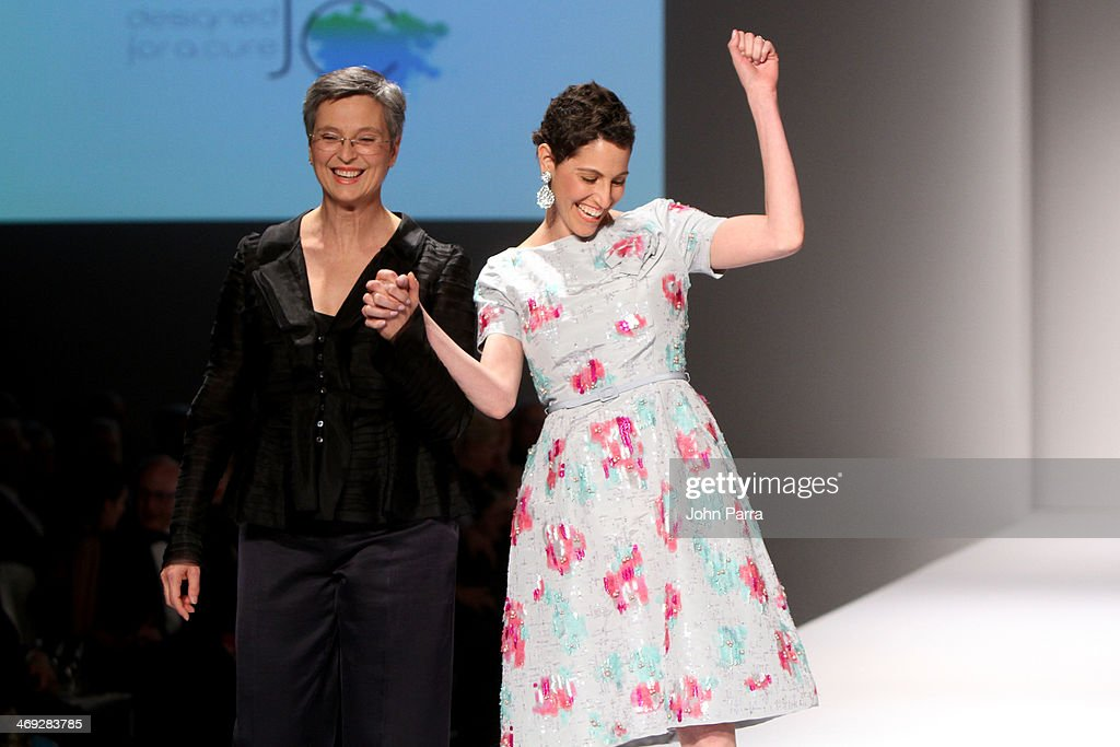 Dr. Joyce Slingerland and Lainey Tobin Kieffer walk the runway during the Oscar de la Renta fashion show at Designed For A Cure 2014 Benefiting Sylvester Comprehensive Cancer Center on February 13, 2014 in Miami, Florida.