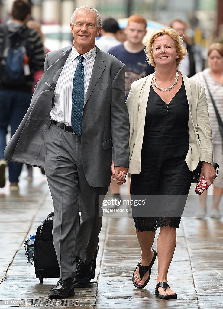 Dr Judith Ames arrives with her fiancee Robert Owens at a Medical Practitioners Tribunal Service hearing where she is charged with misconduct on July 29, 2013 in Manchester, England. Dr Ames, who had treated Robert Owens' wife Joyce before she died from terminal lung cancer in 2012, began a relationship with Mr Owens within weeks of Mrs Owens' death.