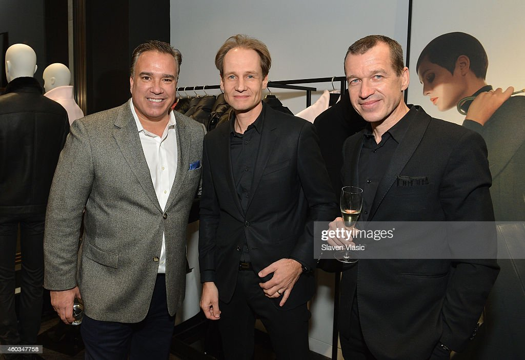 Dr Juergen Gessler CEO Porsche Design Group with guests attend Porsche Design An Evening Of Style at Madison Avenue flagship store on December 11...