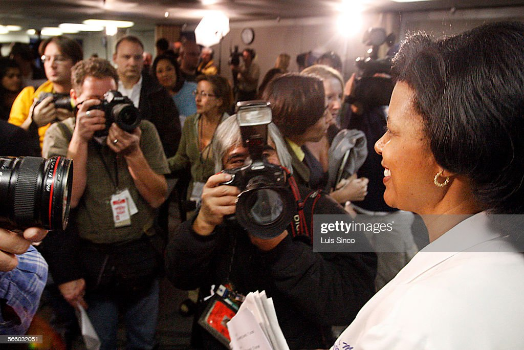 Dr Karen Maples the lead surgeon of the medical team that helped deliver octuplets is swarmed by photogrtaphers following a press conference Tuesday...