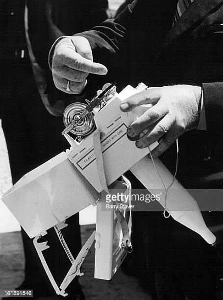 MAY 13 1971 MAY 21 1971 MAY 22 1971 Dr Karl Johannessen associate director of Weather Service points out details of the radiosonde which is attached...