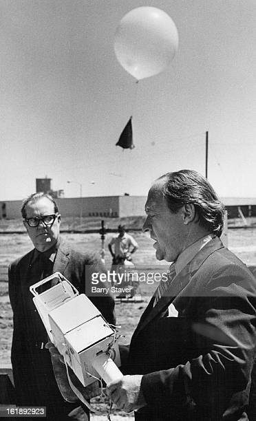 MAY 13 1971 MAY 21 1971 MAY 22 1971 Dr Karl Johannessen right discusses radiosonde which gathers data on air quality as it ascends on balloon...