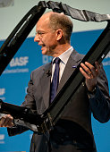 Dr Kurt Bock Chairman of the Board of Executive Directors of BASF SE presents the Front End carrier for VW Golf 7 made of BASF plastic at the Annual...