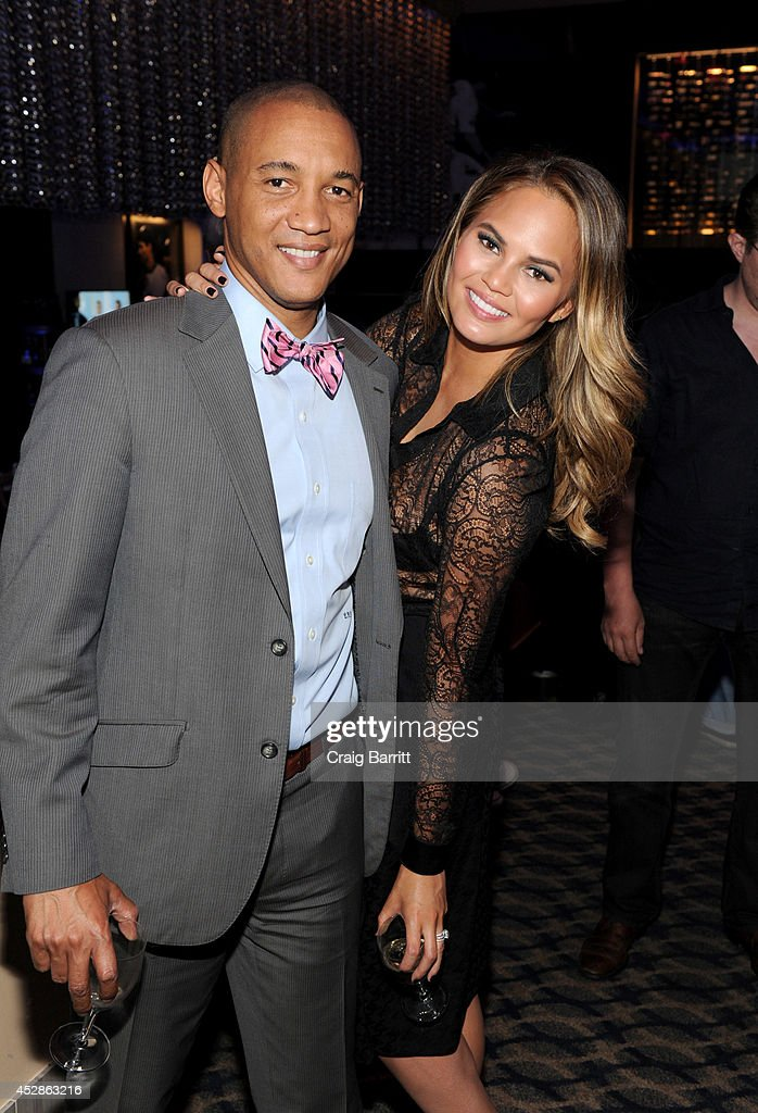 Dr. Lee Gause (L) and model Chrissy Teigen attend DuJour Magazine and NYY Steak celebrating Chrissy Teigen with FENDI timepieces and Moet Ice on July 28, 2014 in New York City.