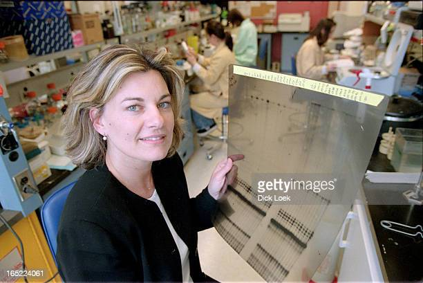 Dr Linda Penn holding a RNase protection assay to detect expression of the myc oncogene in cancer cells