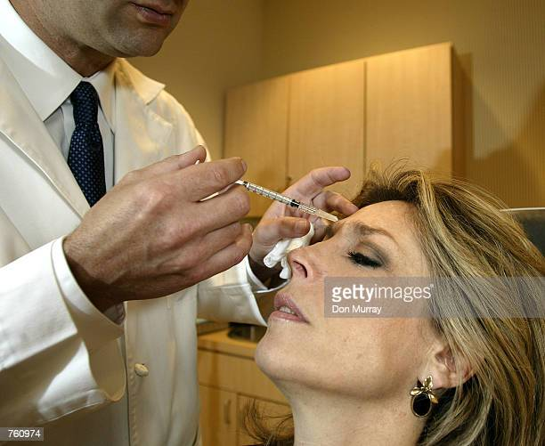 Dr Louis P Bucky MD FACS injects Botox into the face of Betsy Rubenstone from the Philadelphia area April 18 2002 at the Plastic Reconstructive...
