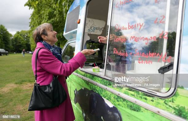 Dr Louise Irvine of the National Health Action Party buys an ice cream as she campaigns in Haslemere Surrey part of the South West Surrey...