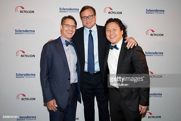 Dr Luke Envin Bob Saget and Eric Kau pose for a photo at Scleroderma Research Foundation's Cool Comedy Hot Cuisine event at the the Fairmont Hotel on...