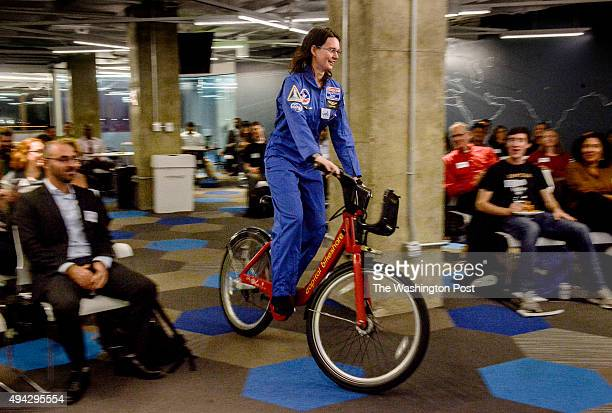 Dr Malynda Chizeck Frouard an astronomer with the Naval Observatory rides up to the podium on a bikeshare vehicle as computer programmers local urban...
