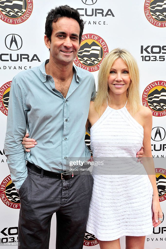 Dr. Marc Mani and actress <a gi-track='captionPersonalityLinkClicked' href=/galleries/search?phrase=Heather+Locklear&family=editorial&specificpeople=204224 ng-click='$event.stopPropagation()'>Heather Locklear</a> attend the Acura/KOST celebrity benefit concert and pageant on August 24, 2013 in Laguna Beach, California.