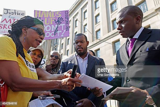 Dr Marsha ColemanAdebayo delivers a letter of demands for Attorney General Eric Holder to Justice Department Press Secretary Kevin Lewis as she and...