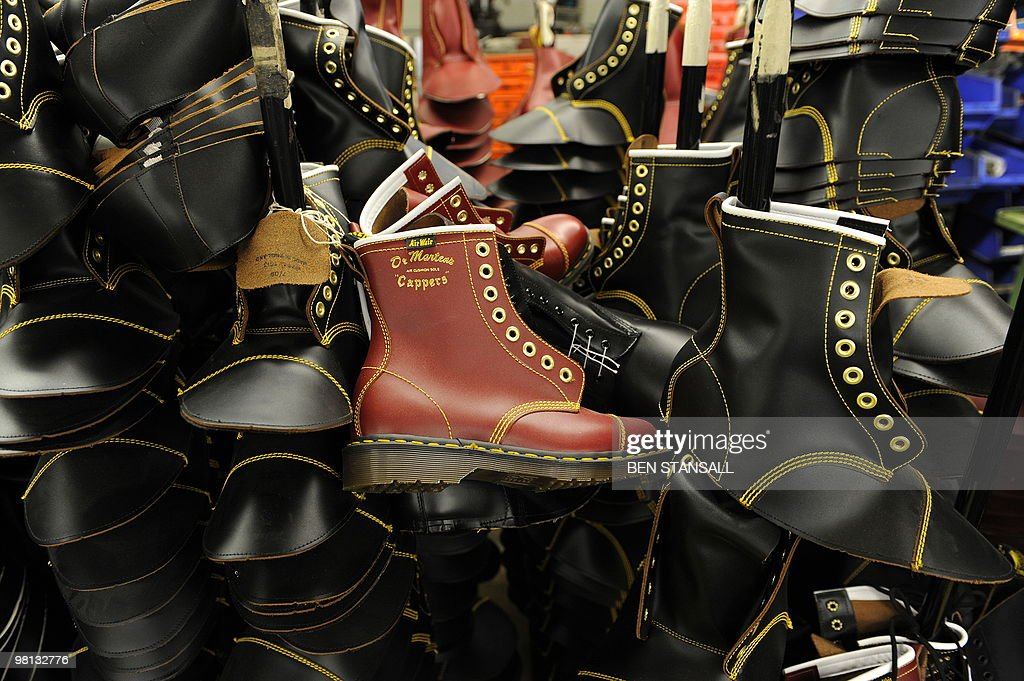 Dr Martens boots are pictured in the Dr Martens factory in Wellingborough Northamptonshire in central England on March 18 2010 What do British 1980s...