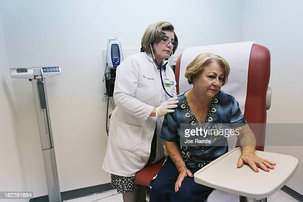 Dr Martha Perez examines Maria Lebron in a room at the Community Health of South Florida Doris Ison Health Center on February 21 2013 in Miami...