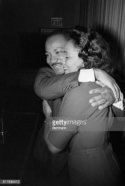 Dr Martin Luther King Jr hugs his wife Coretta during a news conference following the announcement that he had been awarded the Nobel Peace Prize