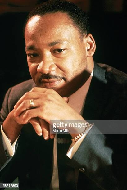 Dr Martin Luther King Jr sits with his hands folded for a portrait circa 1967