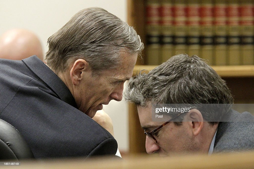 Dr. Martin MacNeill (L) talks with his attorneys in court on the opening day of his trial on October 17, 2013 in Provo, Utah. Prosecutors allege MacNeill hounded his wife Michele MacNeill to get a face-lift in 2007 so he could kill her with a lethal dose of prescription drugs in an effort continue an affair with a younger woman.