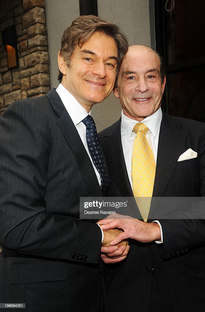 Dr. <a gi-track='captionPersonalityLinkClicked' href=/galleries/search?phrase=Mehmet+Oz&family=editorial&specificpeople=4175862 ng-click='$event.stopPropagation()'>Mehmet Oz</a> and (R) CEO of Apple-Metro Inc., Zane Tankel attend Green And Eco-Friendly Applebee's Ribbon Cutting Ceremony at Applebee's on December 10, 2012 in New York City.