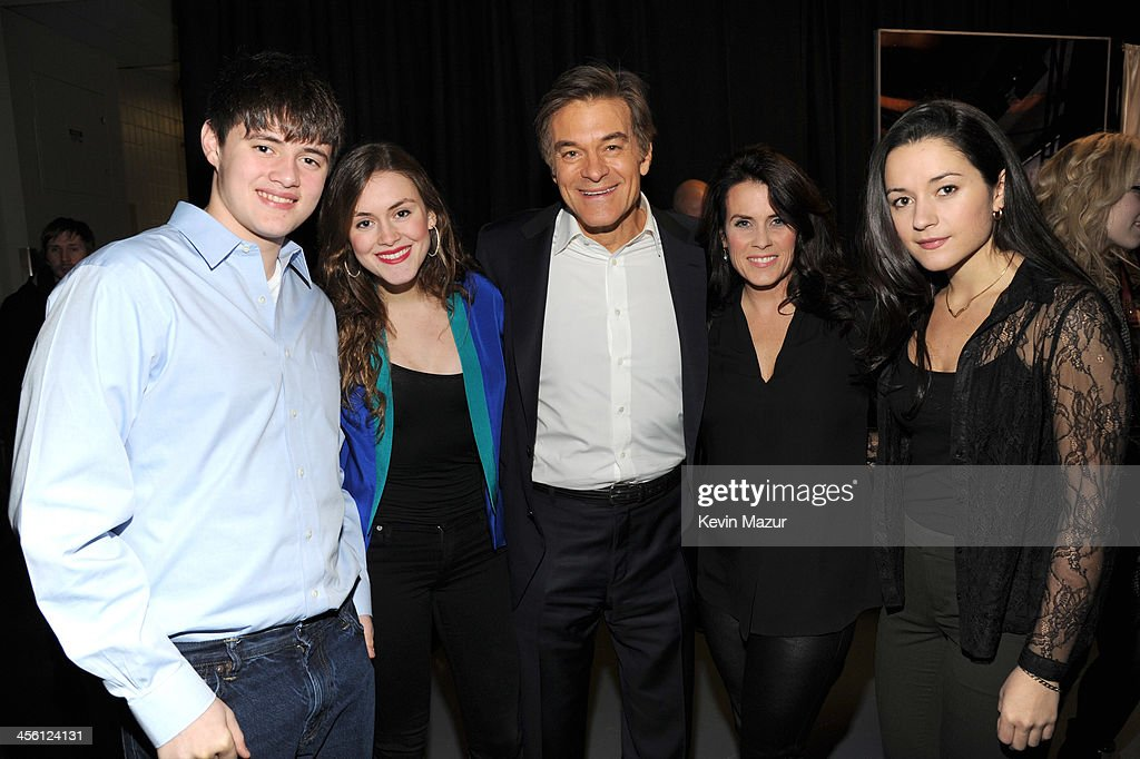 Dr. Mehmet Oz (C) and family backstage at Z100's Jingle Ball 2013, presented by Aeropostale, at Madison Square Garden on December 13, 2013 in New York City.