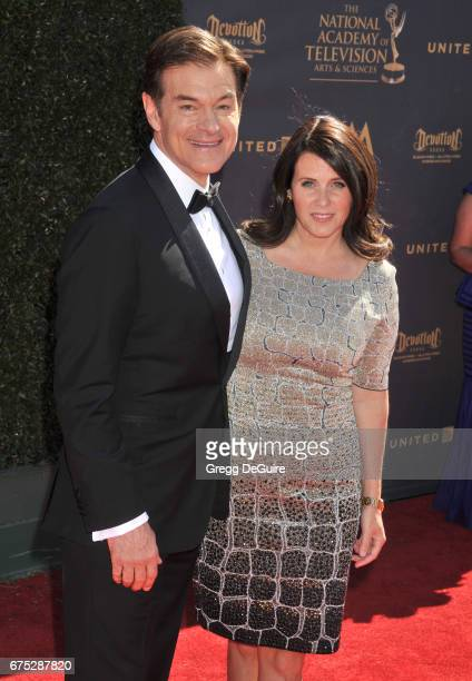 Dr Mehmet Oz and wife Lisa Oz arrive at the 44th Annual Daytime Emmy Awards at Pasadena Civic Auditorium on April 30 2017 in Pasadena California