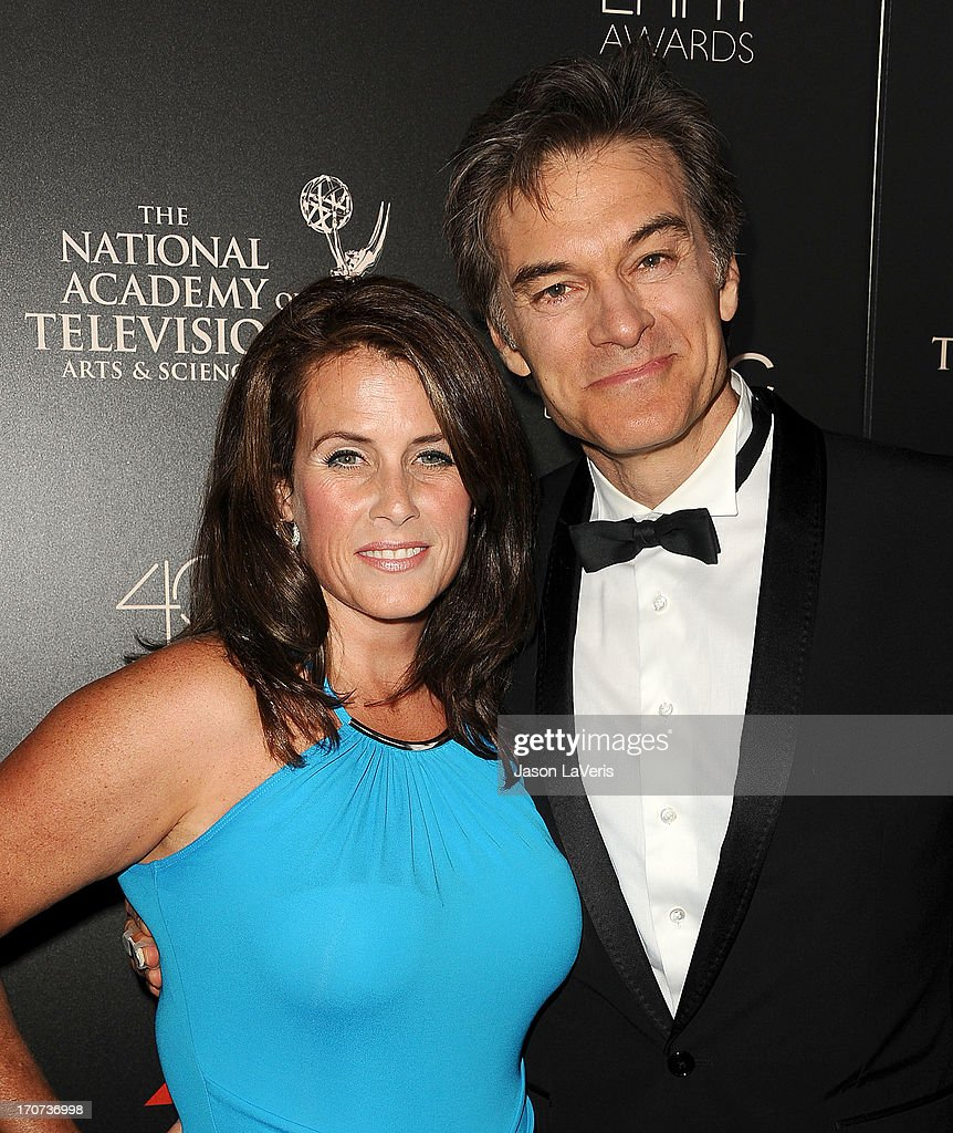 Dr. Mehmet Oz (R) and wife Lisa Oz attend the 40th annual Daytime Emmy Awards at The Beverly Hilton Hotel on June 16, 2013 in Beverly Hills, California.