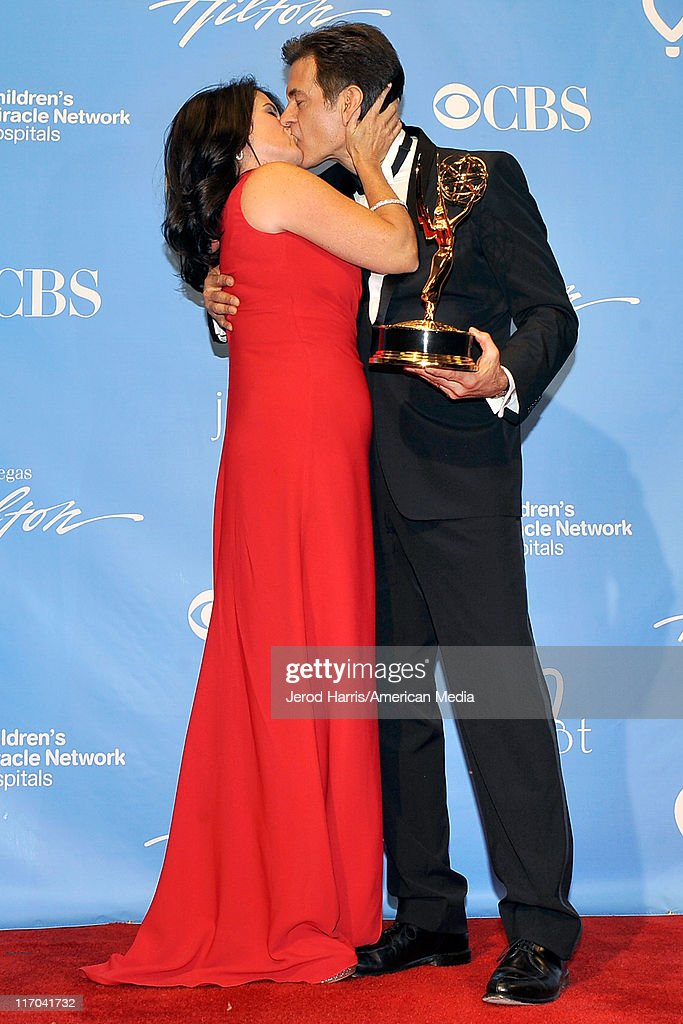 Dr Mehmet Oz kisses his wife Lisa Oz at the 38th Annual Daytime Entertainment Emmy Awards for Soap Opera Weekly - Press Room on June 19, 2011 in Las Vegas, Nevada.